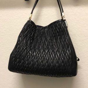 Black leather authentic Coach purse.
